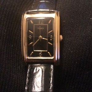 Woman's Timex watch.